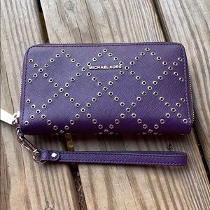 a23e61ed054a09 Michael Kors · Michael Kors large purple wallet/phone wristlet